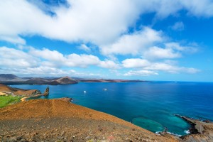 Wide angle view of the Pacific Ocean around Bartolome Island with Pinnacle Rock on the left side in the Galapagos Islands in Ecuador